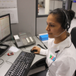 Woman using computer with headset