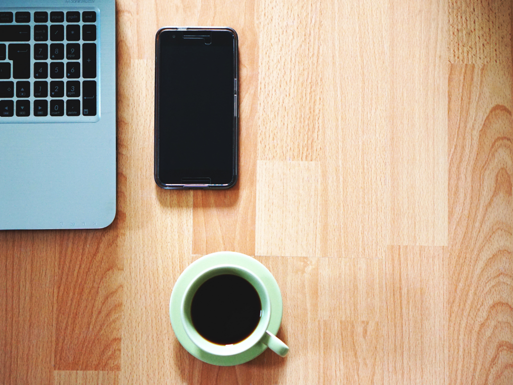 Phone and coffee on a desk